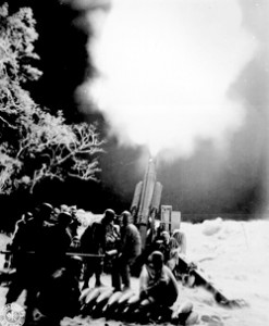 """""""Veteran Artillery men of the `C' Battery, 90th Field Artillery, lay down a murderous barrage on troublesome Jap artillery positions in Balete Pass, Luzon, P.I."""" Morton, April 19, 1945. NARA photo."""