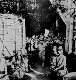 Surrender of American troops at Corregidor, Philippine Islands, May 1942. NARA photo.