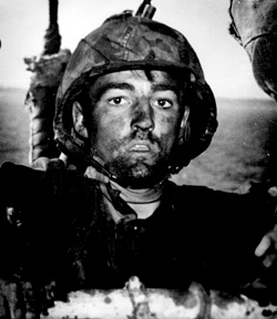 """Back to a Coast Guard assault transport comes this Marine after two days and nights of Hell on the beach of Eniwetok in the Marshall Islands. His face is grimey with coral dust but the light of battle stays in his eyes."" February 1944.  NARA photo."
